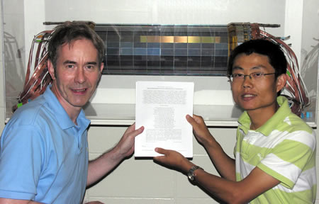 Prof. Ian Shipsey and Graduate Student Bo Xin pose in front of the Si3 silicon detector